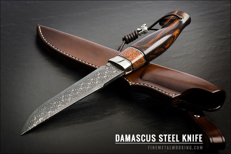 black metal knife made out of damascus steel
